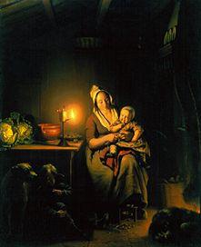 Mère et enfants avec la lumière de bougie